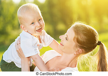 happy Mom and baby son in summer nature - happy family in...