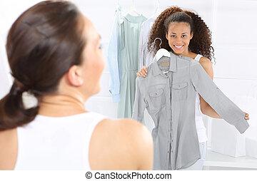 Boutique, women shopping - Two women shopping in boutique...