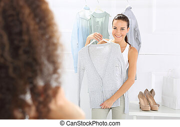 Brand clothing, women shopping - Two women shopping in...
