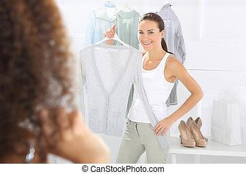 Brand clothing, women shopping - Two women shopping in...