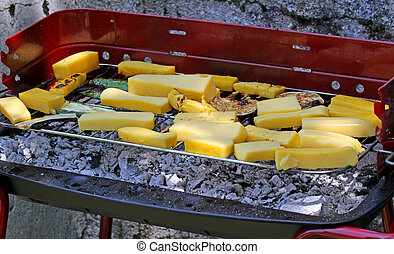 Garden with BBQ grilled meat and slices of yellow polenta 9...