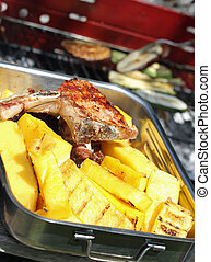 BBQ grilled meat and slices of yellow corn polenta 8 -...