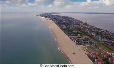 Sandy spit - Aerial shot: Flying over sea and sandy spit