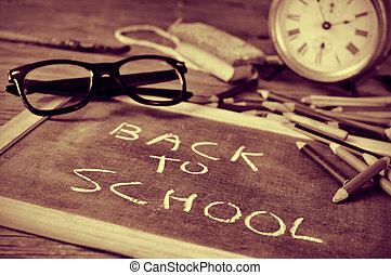 back to school in duotone - a chalkboard with the sentence...