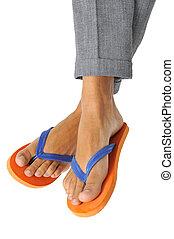 businessman wearing flip-flops - detail of a businessman...