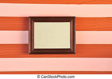 Wooden picture frame on the wall