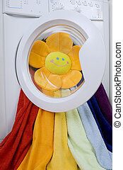 Washing machine, toy and colorful laundry to wash - Washing...