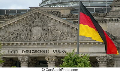 flag in front of the bundestag - A waving german flag in...