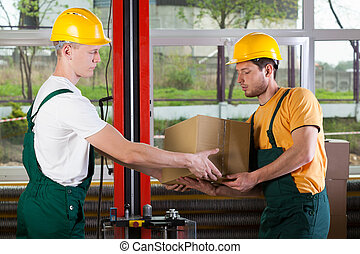 Logistics workers at storehouse