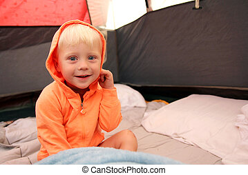 Young Child Waking up in Tent after Camping