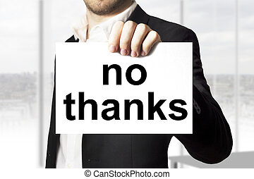 businessman holding sign no thanks - businessman in black...