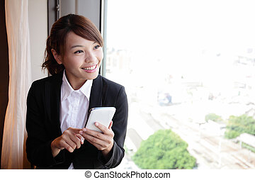 Young business woman using smart phone - Young business...