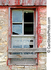 Broken Old Window on Abandoned Barn Background - The glass...