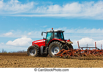 Farmer plowing the field Cultivating tractor in the field...