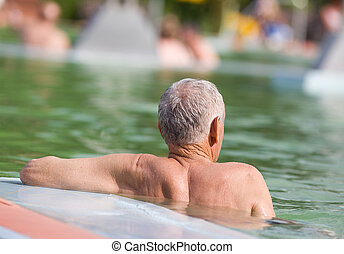 Water enjoyment - Senior man enjoying in swimming pool with...