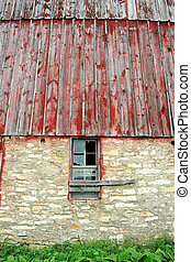 Exterior Wall with Broken Window on Old Barn