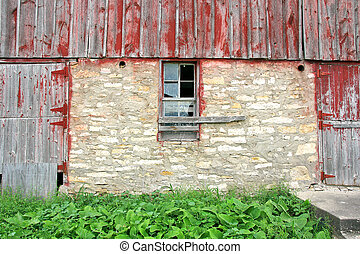 Old Abandoned Barn with Broken Window and Two Wood Doors - A...