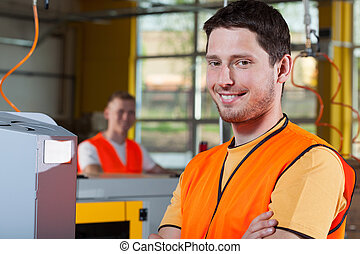Smiling industrial worker at factory - Smiling industrial...