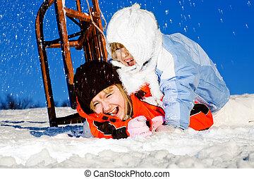 girls crashing at sledding - winter activities. kids...