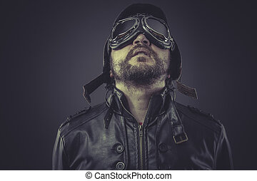 retro pilot dressed in vintage style leather cap and goggles
