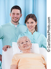 Physiotherapy in geriatrics - Closeup of two young...