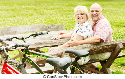 happy elderly couple relaxing - Happy elderly couple...
