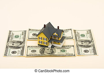 The Cost of Being a Homeowner - A model home with hundred...
