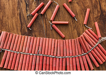 Firecrackers - Roll of firecrackers on wood table.