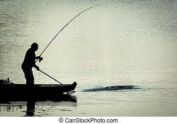 Fisherman Catching Fish on a Twilight Lake