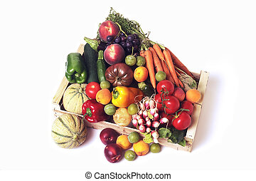 crates of fruit and vegetables on white background in studio...