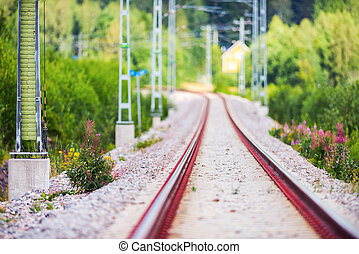 Railtrack in a curvy section with short depth of field in...