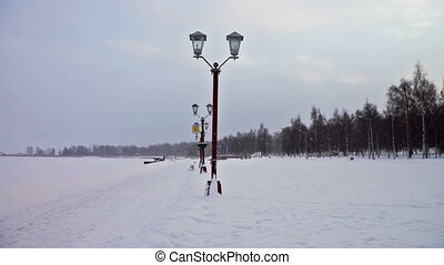 Footpath in snow at Onega lake quay - PETROZAVODSK, RUSSIA -...