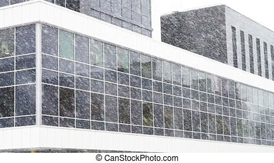 Exterior of new office building in snowfall