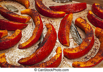 Roasted pumpkin on tray - Roasted and spiced pumpkin slices...