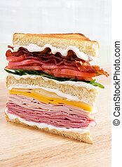 Mega Club Sandwich - A classic club sandwich with ham,...