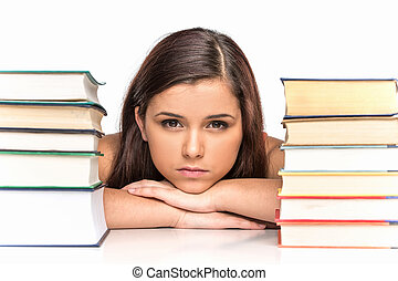 picture of upset student with stack of books. sad female...
