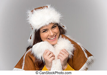 Young woman wearing winter coat beautiful girl standing...