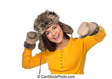 happy woman celebrating wearing winter hat. Dynamic...