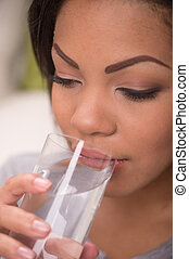 Portrait of young pretty woman drinking. Girl with healthy cool water in glass