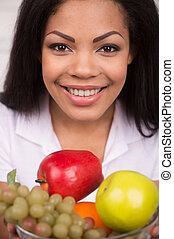 Closeup African AMerican woman with green apple. Beautiful...
