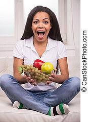 Closeup African AMerican woman with fruits. Beautiful...