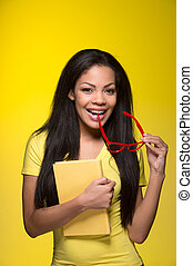 Closeup portrait of young happy woman student biting red...