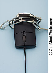 Online Security - A computer mouse with a metal chain...