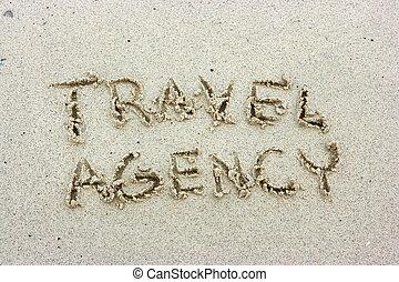 Travel agency inscription on the sand beach