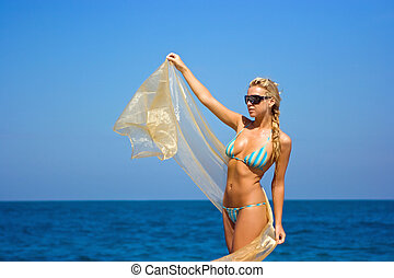Lady with transparent shawl - Blonde lady in sunglasses with...