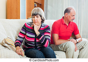Mature woman having conflict with husband at home