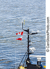 Canadian Flags on Yellow Pilot Boat - A bright yellow pilot...