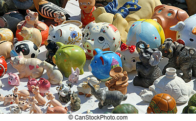 antique piggy banks for sale at flea market stall - many...