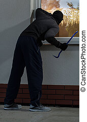 Burglar before burglary - Vertical view of a burglar before...