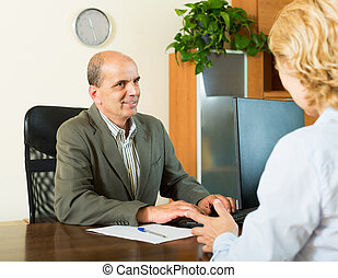 Pensioner at notary's office - Pensioner discussing...